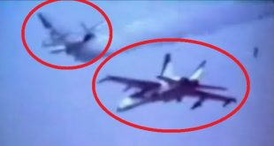 Footage of F-18 Hornet dummy bomb hitting A-4 Skyhawk chase plane during bombing test