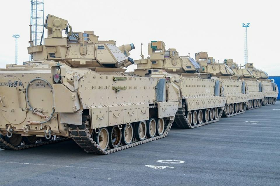 Combat vehicles of the 1st Armoured Brigade Combat Team are unloaded at port ahead of training in support of Operation Atlantic Resolve, meant as a show of force near Russia's border with Europe. (Credits: Sgt. Christopher Case/US Army)