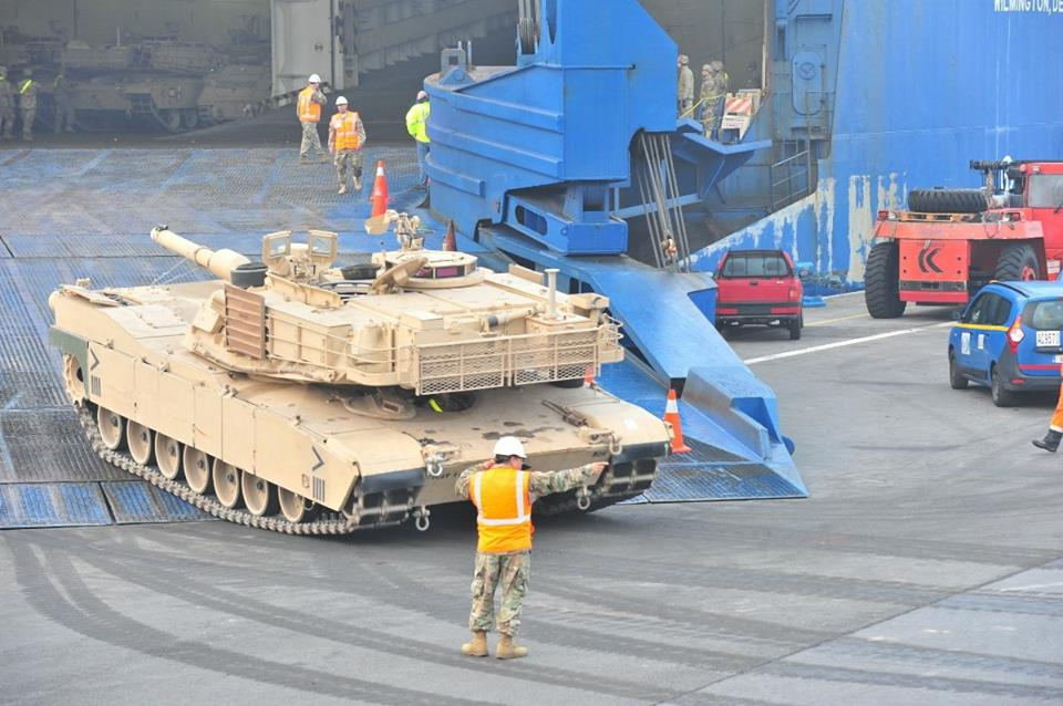 A U.S. Army soldier guides an M1 Abrams tank from 1st Armoured Brigade Combat Team, 1st Cavalry Division off the ramp of the ARC vessel Endurance at the Port of Antwerp, Belgium. The unit arrived as part of Operation Atlantic Resolve. (Credits: Sgt. 1st Class Jacob A. McDonald/U.S. Army)