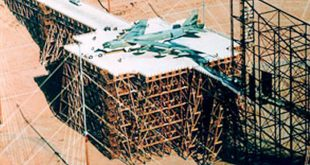 B-52 BOMBER SITS ON A GIANT TRESTLE