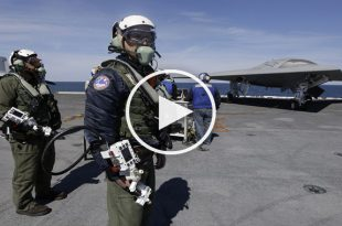 See how US navy controls X-47B Drone with 'Cyborg'/ Robotic Arm