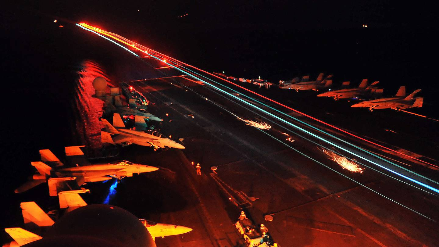 Fighter jet landing On An Aircraft Carrier On A Stormy Night