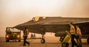 An F-35 is secured by personnel at Luke AFB.