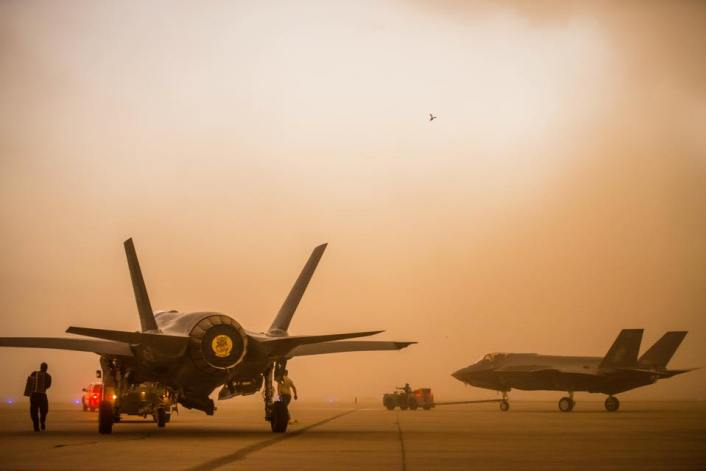 5th generation aircraft engulfed in dust.