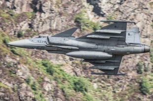 Gripen Dropping a Laser-Guided Bomb on a Forest Fire