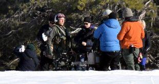 Tom Cruise Runs In Flight Suit through the snow