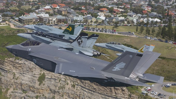 Royal Australian Air Force F/A-18 Hornets fly in formation with an F-35A Joint Strike Fighter over Newcastle, NSW. Image credit: CPL David Gibbs/ © Commonwealth of Australia, Department of Defence