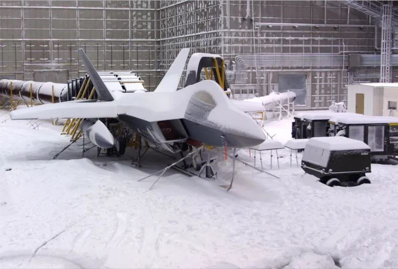 Air Force's F-22 Raptor covered with snow during weather testing.