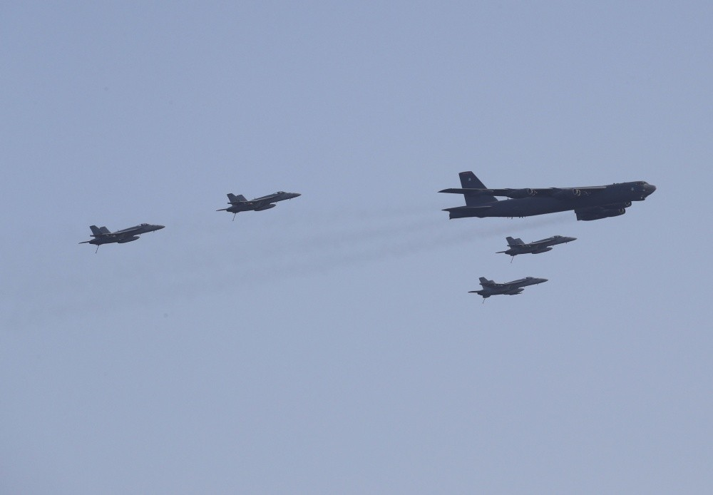 Fighters and bombers fly over the Arabian Sea during combined arms exercises. US Navy photo by Lt. Brad Kerr