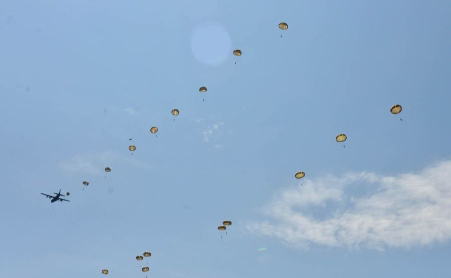 Paratroopers float down from the sky near Sainte-Mere-Eglise, France, Sunday June 3, 2018. Marking the 1944 battle at La Fiere, 575 troops jumped from eight aircraft including U.S. Air Force C-130s.