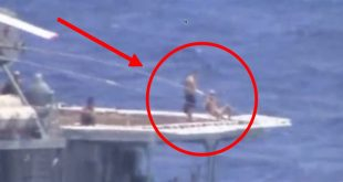 Shirtless Russian sailors casually sunbathe during a Near-collision between U.S. and Russian warships