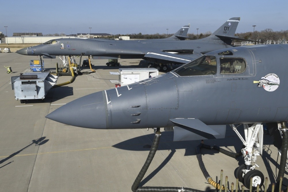 Boeing B-1B Lancer, serial # 86-0098, wearing 'Midnight Train' nose-art leads a trio of aircraft at the Maintenance, Repair and Overhaul Training Center Jan. 17, 2019, Tinker Air Force Base, Oklahoma. MROTC is a facility used for heavy aircraft maintenance in a public/private partnership between the Air Force and Boeing. (U.S. Air Force photo/Greg L. Davis)