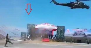 Indonesian Low Flying Mi-35P Helicopter Accidentally Blows Down VIP podium At Army Parade