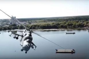 Footage Of Near Miss Between Russian Mi-24 Helicopter & Drone During Military Exercise